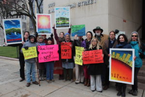 crowd of people at a Syracuse anti-nuclear protest holding signs